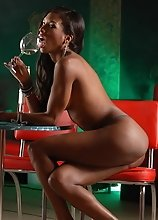 Sweet Natassia strips in a diner