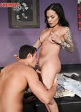 Foxxy has a hot body, big boobs and a juicy big ass! Watch this tgirl sucks Giovanni's big cock before he fucks her ass in this hot hardcore scen