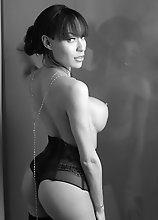 Big dick Mia poses in black & white