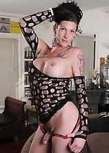 Big dicked Morgan posing in sexy net dress