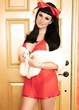 Bailey Jay is such a cutie naked with her massive dick out wearing a cute red bow